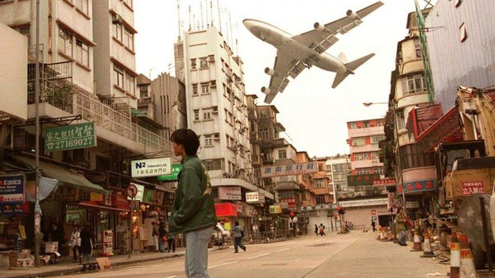 Image: Aircraft on dramatic approach into Hong Kong's Kai Tak Airport. Kai Tak was decommissioned in 1998, with operations shifting to the new HKIA on Lantau Island.