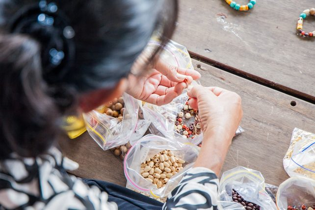 Image: Beading Classes established by Hands On Journeys created jobs for people living on houseboats in Chau Doc, Vietnam. Credit: Hands On Journeys.