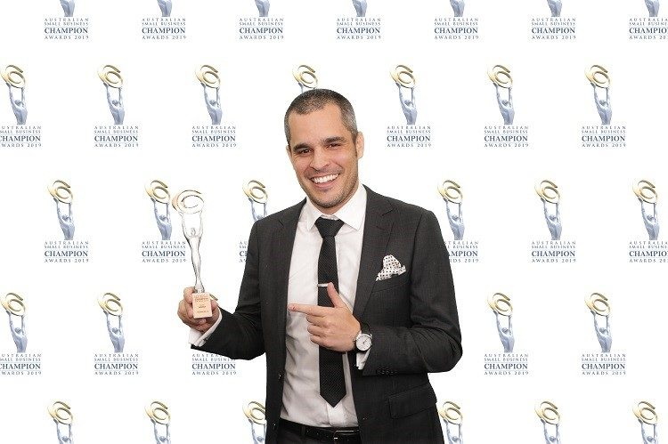 Founder and CEO of The Bucks Co, Julian Haines with the Small Business Champion Award.