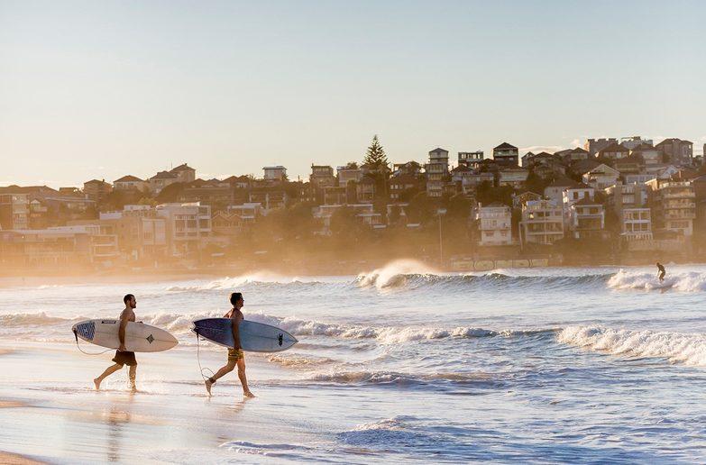 A morning surf at Bondi Beach. Credit: Destination NSW