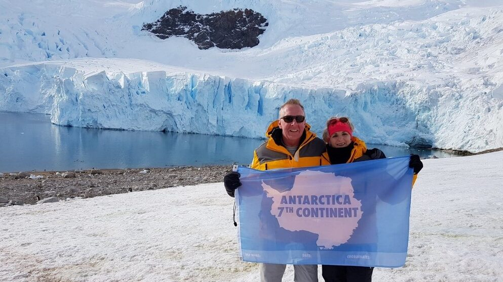 Image: Jeanette and Paul happy in Antarctica before COVID-19 impacted their adventure.