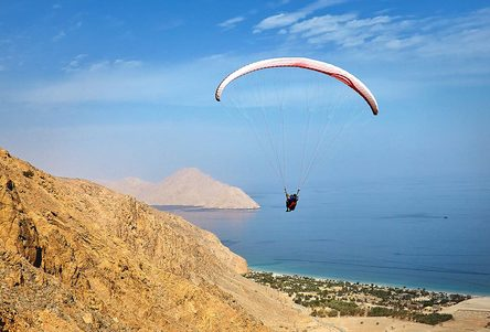Six Senses Zighy Bay's paragliding arrival option. Image credit: Six Senses Zighy Bay