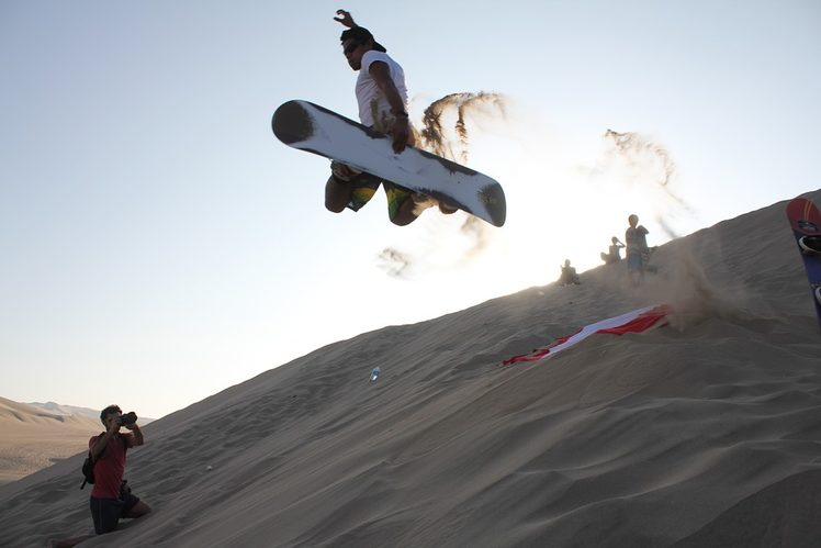 Sandboarding in the dunes at Huacachina, Peru. Image credit: Pixabay
