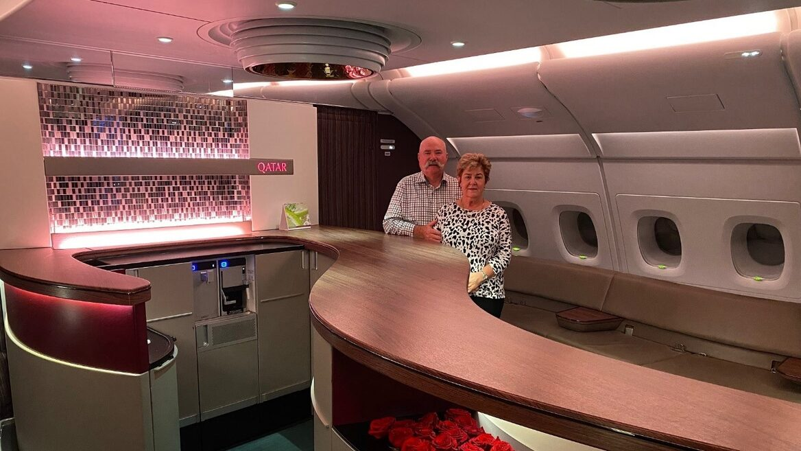 Image: JD and Annabelle safely on their way home aboard a Qatar Airways jet. Credit: JD and Annabelle.
