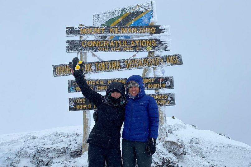Peta (left) at the summit of Kilimanjaro. Credit: Peta Godfrey.