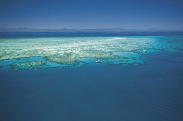 The Great Barrier Reef, stretches along the coast of Queensland