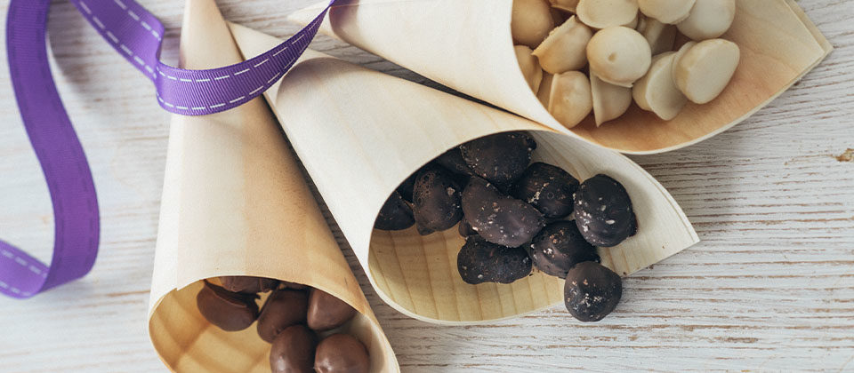 Trio of chocolate coated macadamias