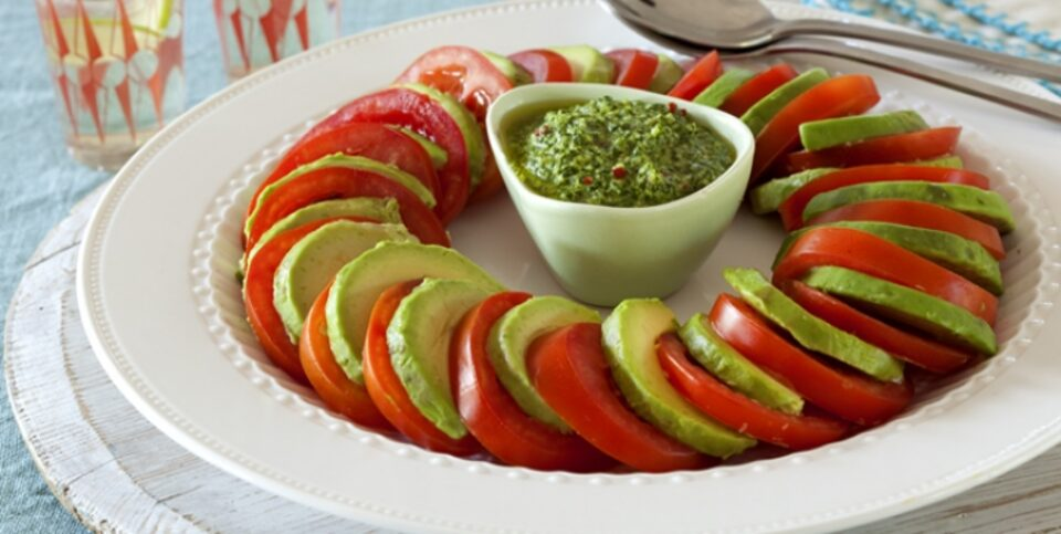 Tomato and avocado salad with macadamia and coriander dressing