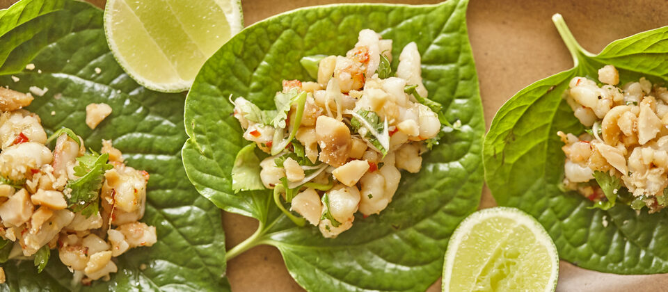 Betel leaves topped with prawns and roasted macadamias