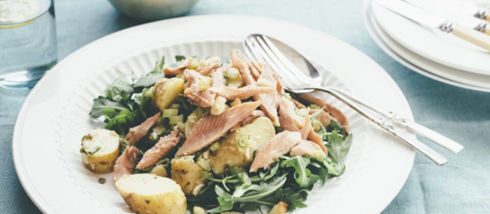 Smoked trout, potato and rocket salad with preserved lemon macadamia mayonnaise dressing