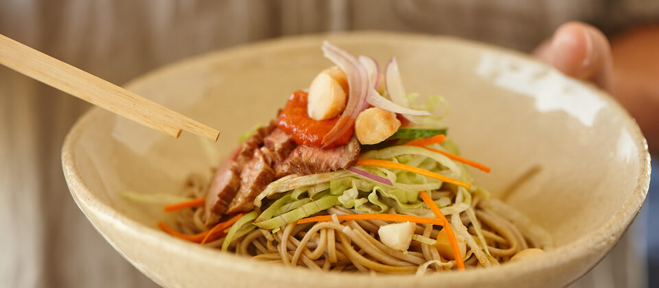 Cold soba noodle bowl with macadamia hot sauce