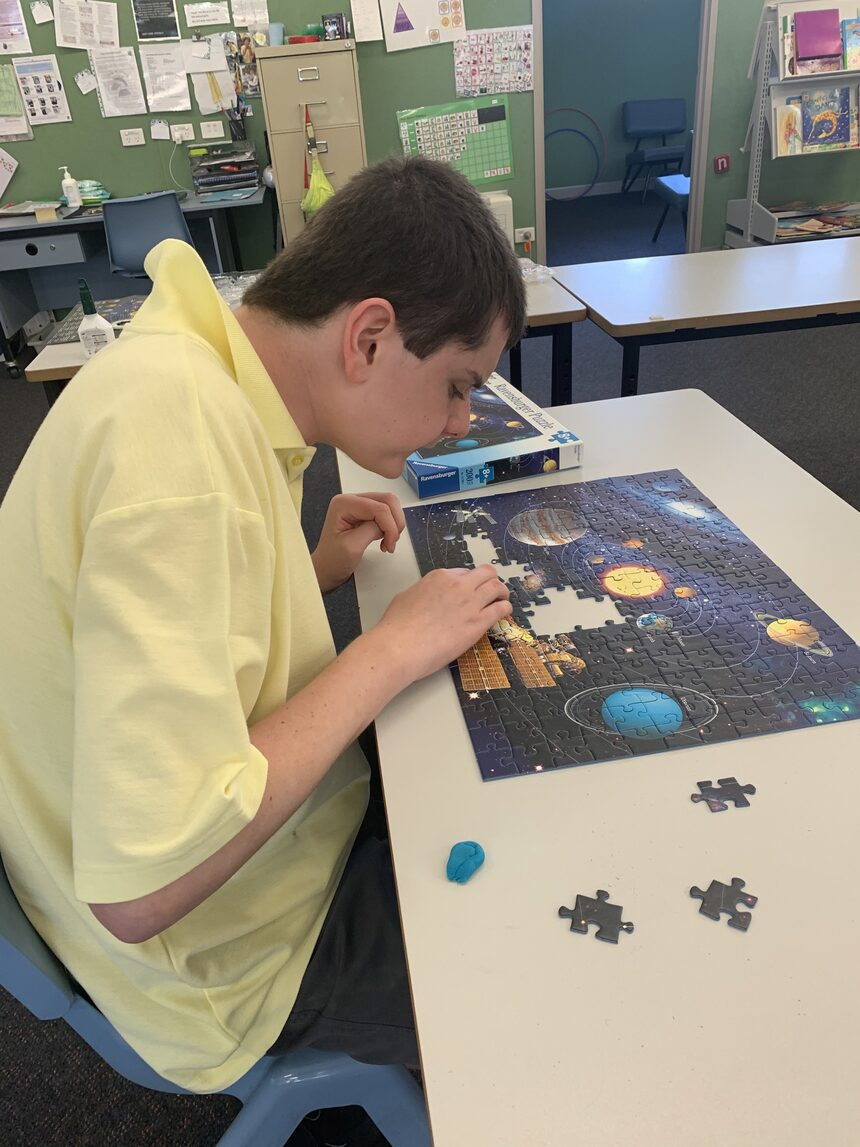 Ryan working hard on one of his jigsaw puzzles