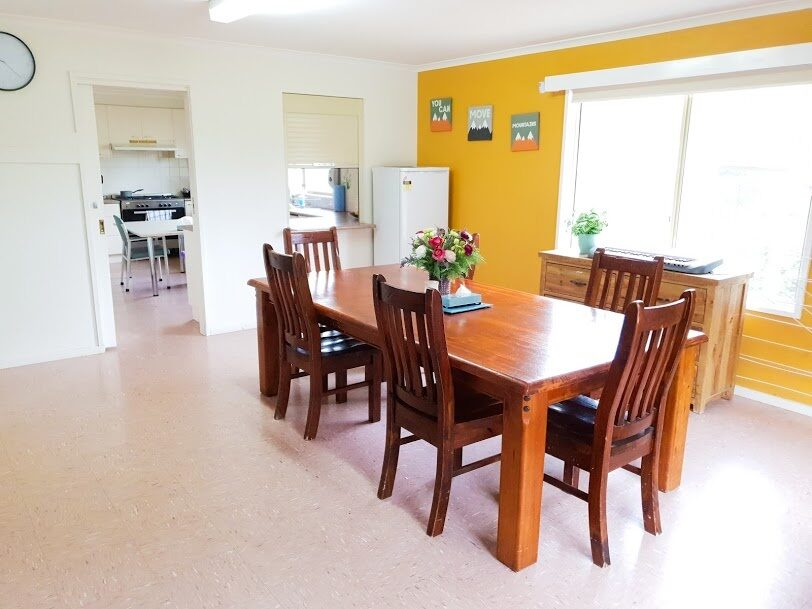 Dining room with timber table and five chairs