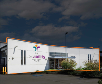 white building with Disability Trust logo on front