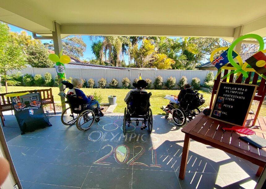 three people in a wheelchairs playing sport for olympics