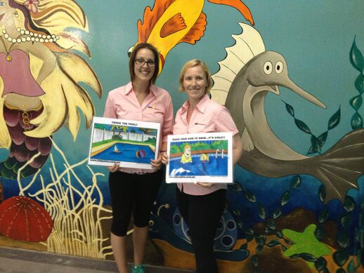 Two Community Speakers Holding Swimming Safety Cards