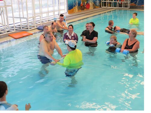 Image of a special needs swimmer participating in aquatic activity