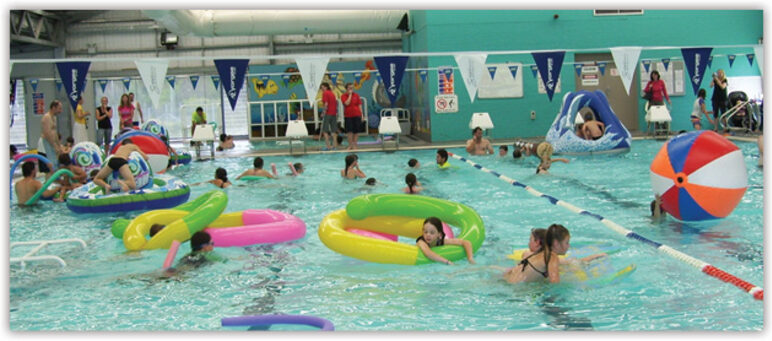 Image of children playing on floatation devices in pool