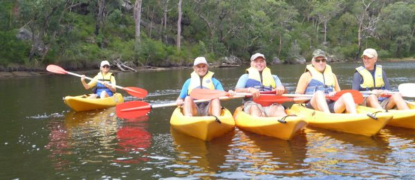 People in kayaks on guided Bundeena kayak tour