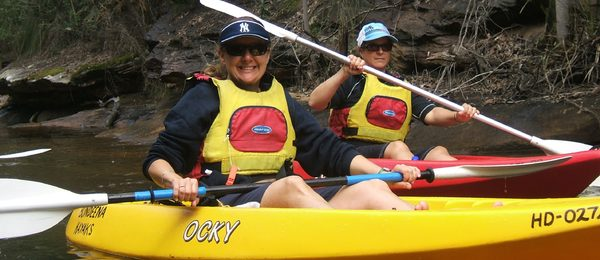 People in kayaking paddling at Bundeena